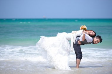 Just married young couple celebrating and have fun at beautiful
