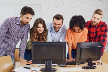 students talking at front of computer