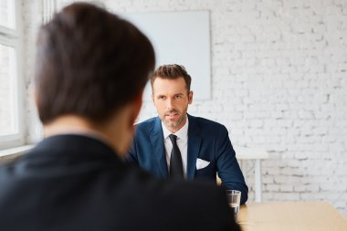 recruiter negotiating  terms with candidate