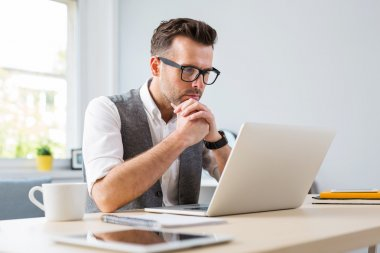 Man in glasses working