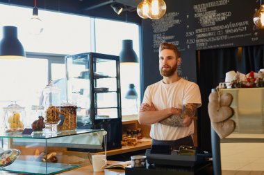 Barista in coffee shop standing