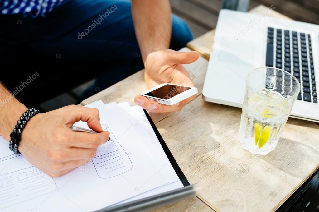Man drawing blueprint of mobile application stock photo baranq man drawing blueprint of mobile application stock photo malvernweather Choice Image