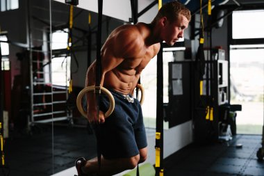 Man working out on gymnastic rings