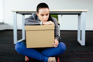 Depressed woman sitting on the floor