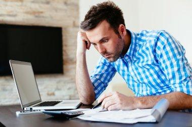 Man calculating his home bills