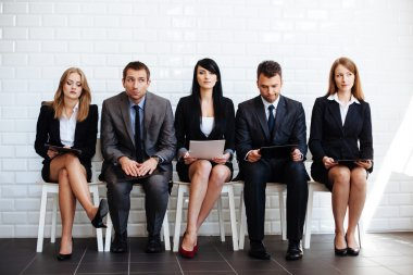 Business people waiting for interview