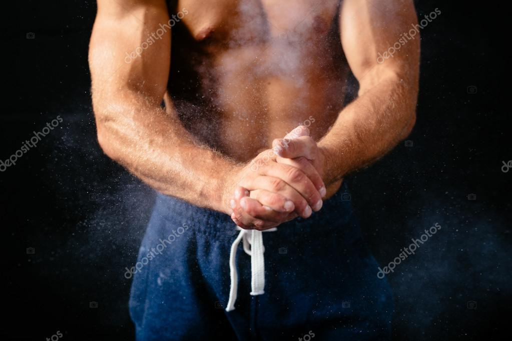 Muscular torso and hands — Stock Photo © baranq #68852145