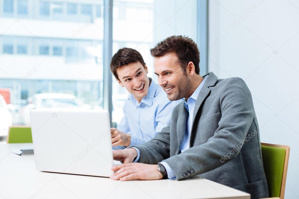 Two businessmen working on laptop