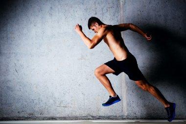 Runner against concrete wall