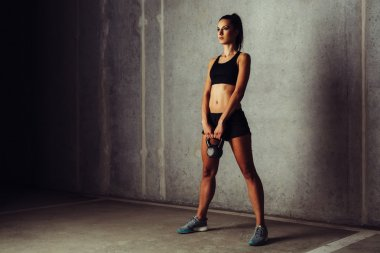 Woman getting ready for kettlebell swing