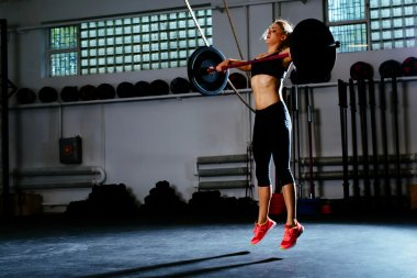 Woman training snatc