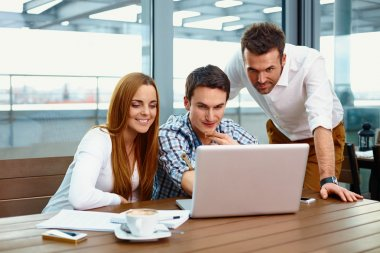 Three business partners working together