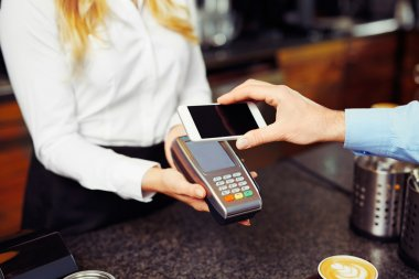 man making payment transaction with phone