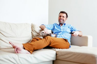 man relaxing in front of TV