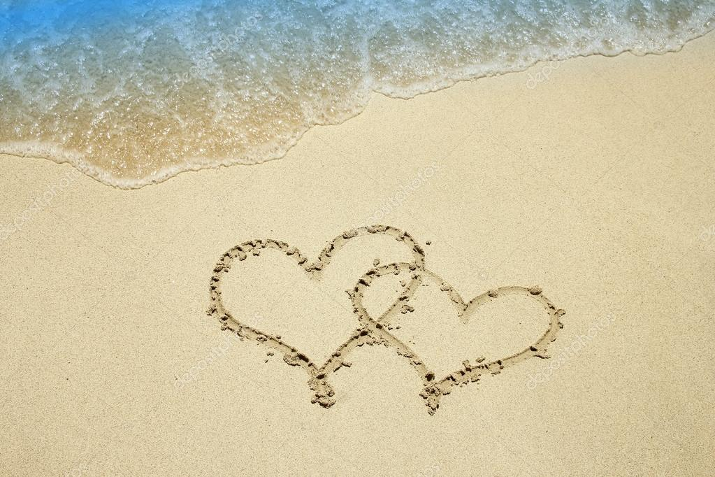 heart on sandy beach