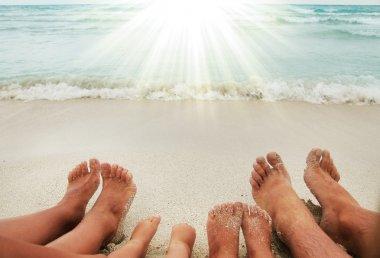 Family feet on the sand