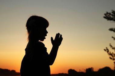 silhouette of little girl