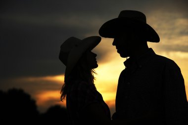 Silhouette of couple in cowboy hats