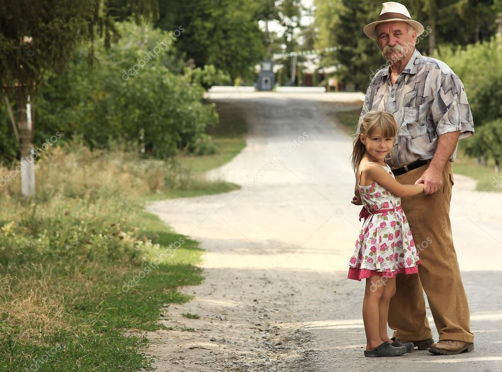 grandfather with granddaughter  on road