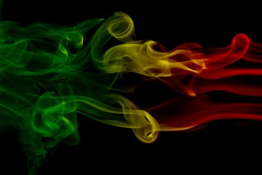 Smoke background reggae colors green, yellow, red colored in flag of reggae music