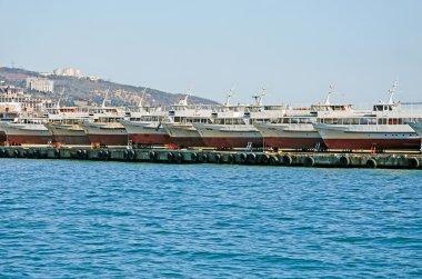 Boats on pier in seaport