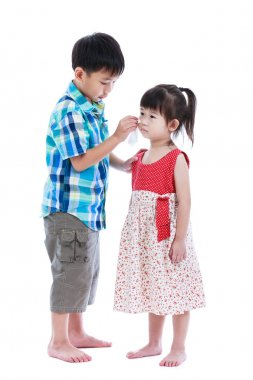 Full body. Elder brother is comforting his crying sister. Isolated on white.