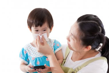 Asian mother carrying and blowing nose her daughter on white bac
