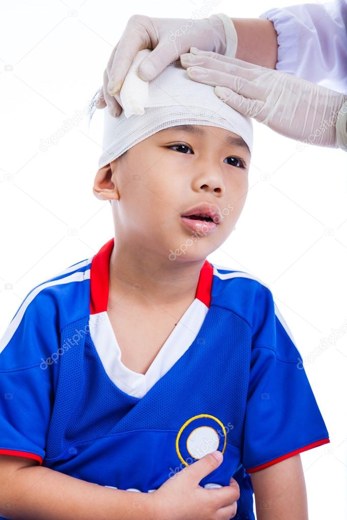 Sports Injury Doctor Makes A Bandage On Head Patient On White