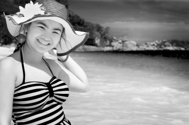 Black and white girl on the beach at Thailand