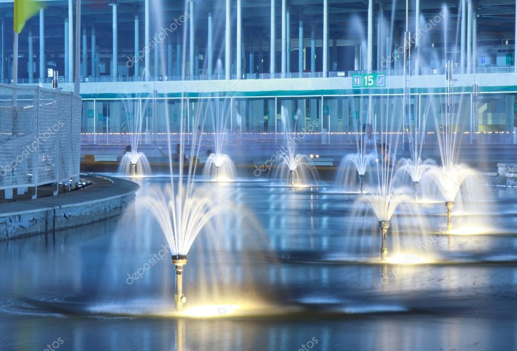 Water fountain lit up at night