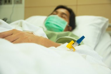 Hospital patient with drip - Stock Image