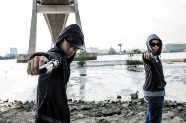 Two killers aiming guns