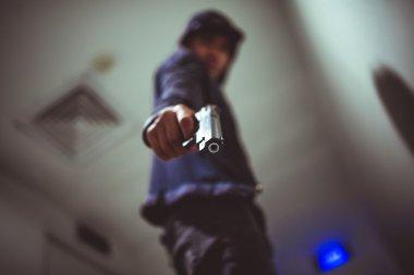 Man pointing a gun at you. Killer with gun stock vector