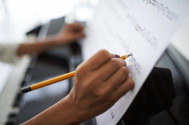 hands correcting music score