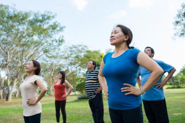 people practicing breathing exercise