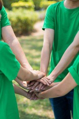 volunteers stacking hands