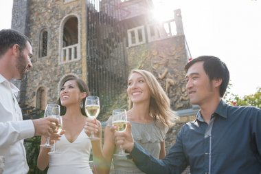 Multi-ethnic people drinking champagne