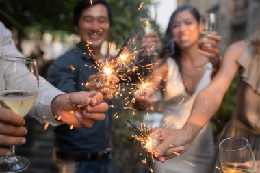 People glowing sparklers