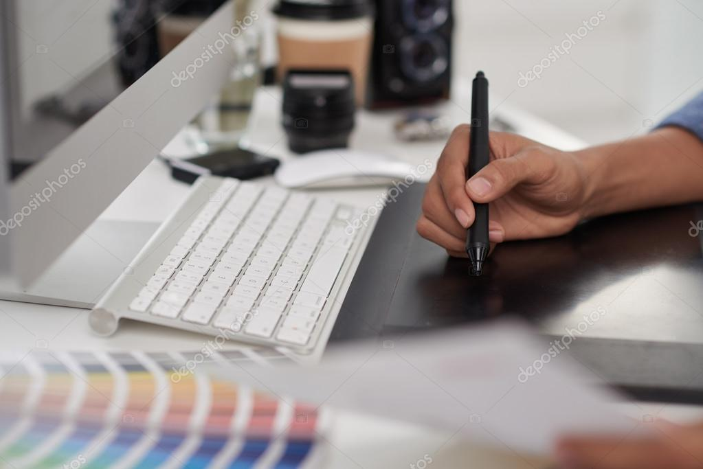 Designer using stylus and tablet