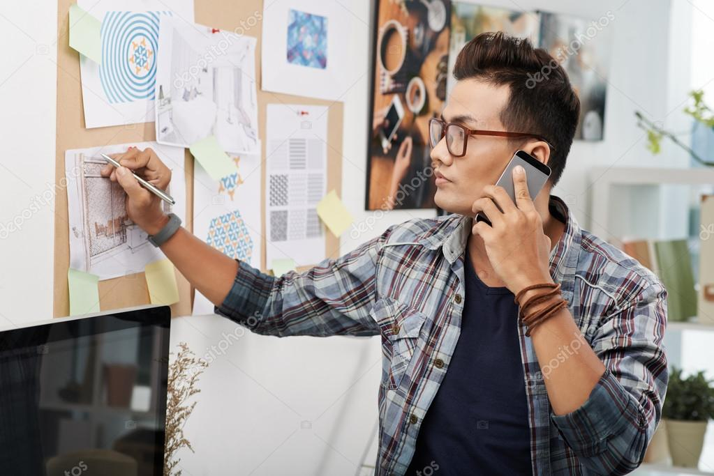 Interior designer talking on phone