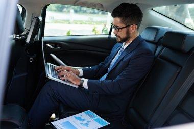 Man preparing for presentation in car