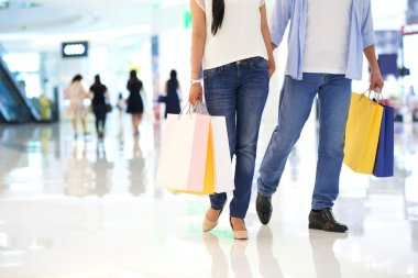 Shopping couple walking in mall