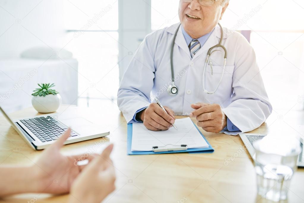 Doctor listening to complaints of patient
