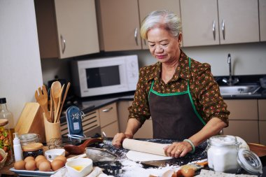 Woman rolling out cookie dough