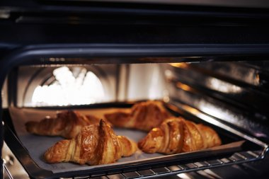 crispy tasty croissants in oven