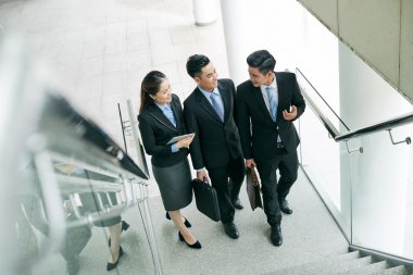 business people talking at stairs