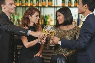couples having double date in restaurant