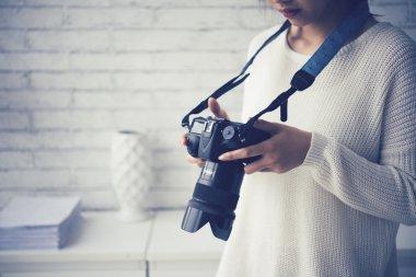 photographer checking photos in camera