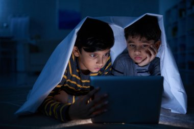 children watching movies on tablet