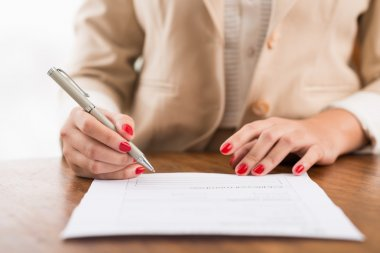 Female hands filling the document